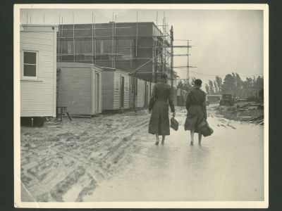 Two boys walking through the building site of HBHS1